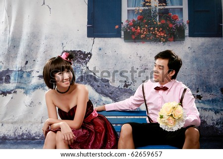 Portrait of young couple in lovely action - stock photo