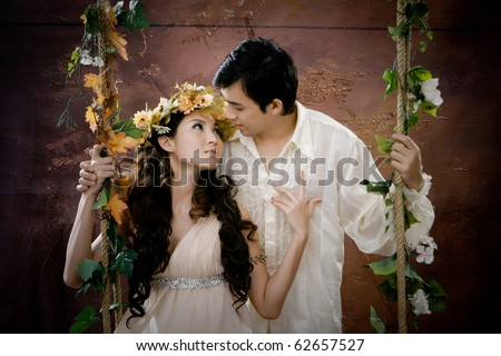 Portrait of young couple kissing each other in greece background - stock photo