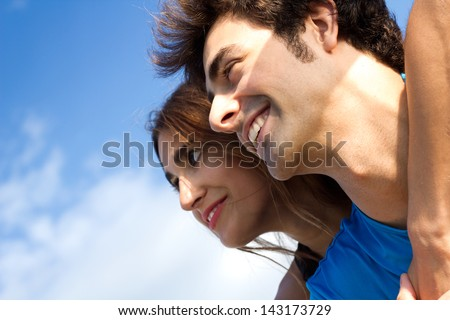 portrait of young couple looking at the horizon