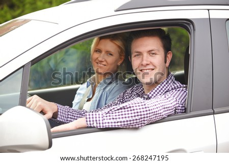 Portrait Of Young Couple Looking Out Of Car Window - stock photo