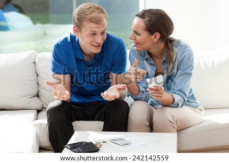 Portrait of young couple not having money - stock photo