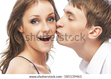 portrait of young couple posing, on white background. - stock photo