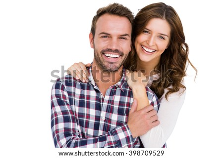 Portrait of young couple smiling on white background - stock photo