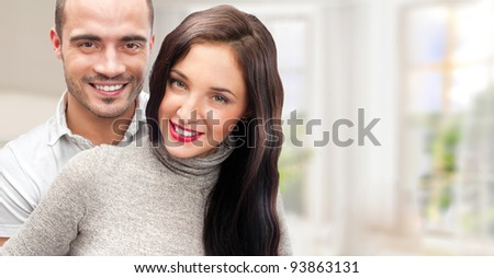 Portrait of young couple standing together at their home. Mortgage concept - stock photo