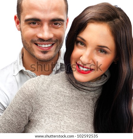 Portrait of young couple standing together isolated against white background. Mortgage concept - stock photo