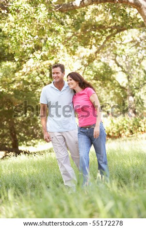 Portrait Of Young Couple Walking In Park - stock photo