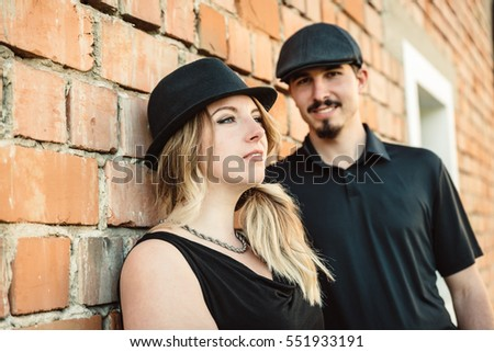 portrait of young couple wearing black clothes