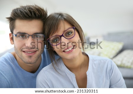 Portrait of young couple with eyeglasses on - stock photo