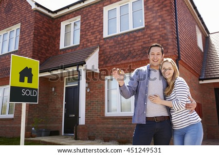 Portrait Of Young Couple With Keys To New Home - stock photo