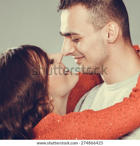 Portrait of young couple woman man face to face. - stock photo
