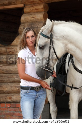 Portrait of young cowgirl and horse outdoors
