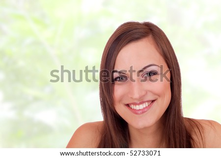 Portrait of young cute girl over abstract studio background