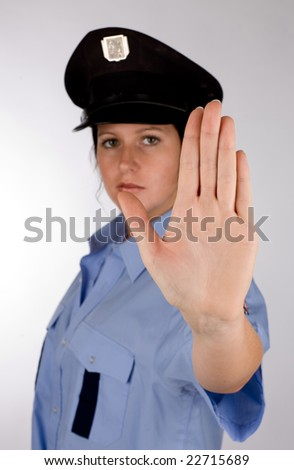 Portrait of young czech police woman in photo studio. - stock photo