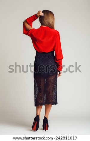 Portrait of young dancing girl with smart fair hair. Fashion photo. Fashion photo of young magnificent woman in red dress. Studio photo. Pretty young lady in a fashion pose - stock photo