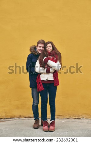Portrait of young dates in winterwear posing outdoors  - stock photo