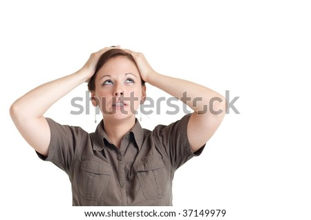 Portrait of young disappointed woman holding her head with both hands. Isolated over white background. - stock photo