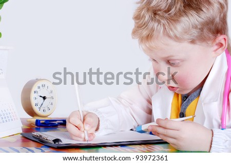 Portrait of young doctor fills the patient's card - stock photo
