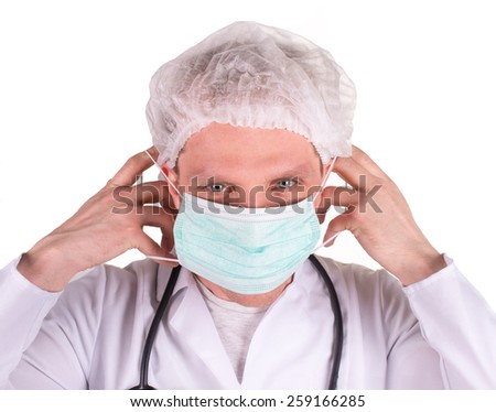 portrait of young doctor in mask and blue gloves thumbs up, isolated on white - stock photo