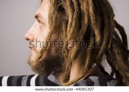 portrait of young dreadlock man - stock photo