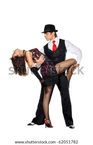 Portrait of young elegance tango dancers in action. Isolated over white background