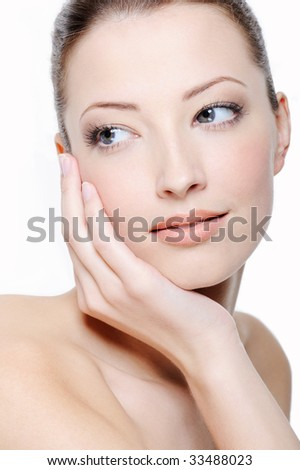 portrait of young elegance woman stroking her beautiful face - stock photo
