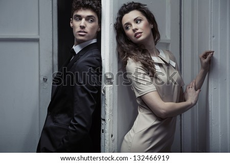 Portrait of young elegant couple - stock photo