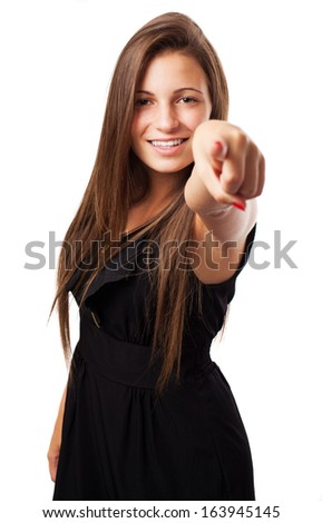 portrait of young elegant woman pointing with finger on white - stock photo