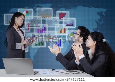 Portrait of young entrepreneur get applaud from her workers when lead a business meeting - stock photo