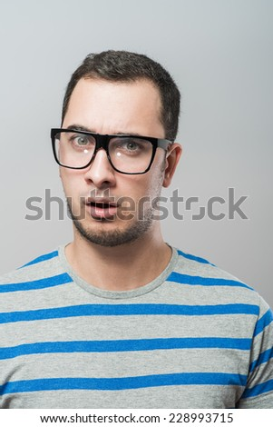 Portrait of young executive looking very excited - stock photo