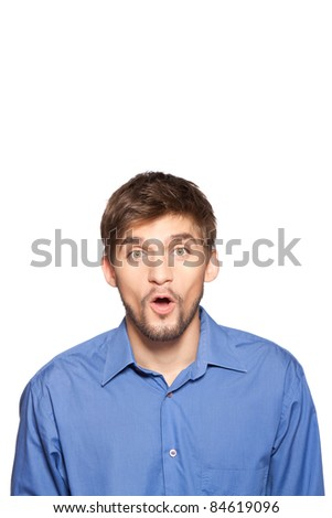 Portrait of young executive looking very surprised astonished businessman, isolated over white background, series of photos. - stock photo