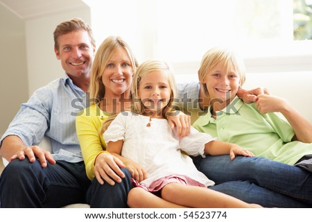Portrait Of Young Family Relaxing Together On Sofa - stock photo