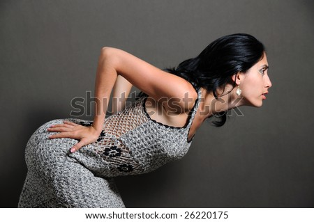 Portrait of young fashion woman leaning to front - stock photo