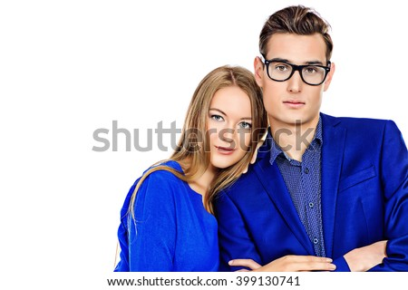 Portrait of young fashionable couple over white background. Isolated. - stock photo
