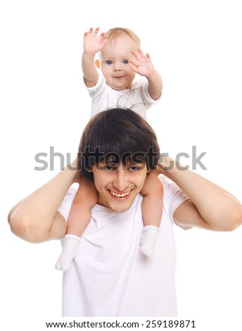 Portrait of young father and child having fun together - stock photo
