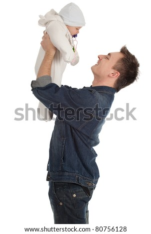 portrait of young father holding lovely seven months old son - stock photo