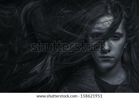 Portrait of young female beauty with long dark hair in black and white - stock photo