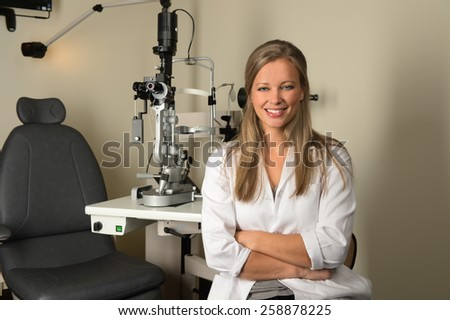 Portrait of young female doctor smiling inside office