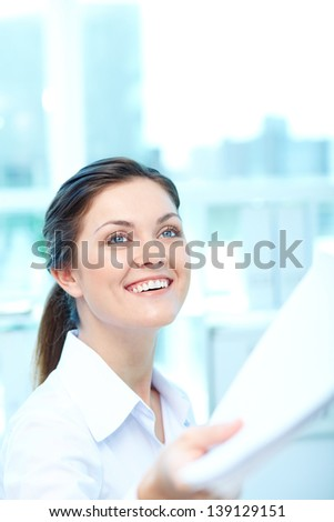 Portrait of young female giving application to conductor - stock photo