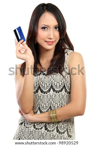 portrait of young female holding credit card isolated on white background - stock photo