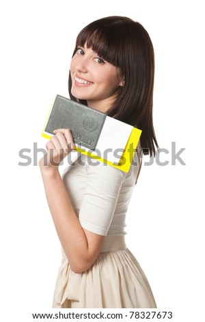 Portrait of young female holding her passport and tickets isolated on white background - stock photo