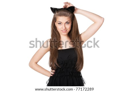 Portrait of young female in black cocktail dress and pussycat ears  isolated on white background - stock photo