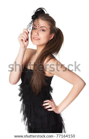 Portrait of young female in black cocktail dress and the hat with veil isolated on white background - stock photo