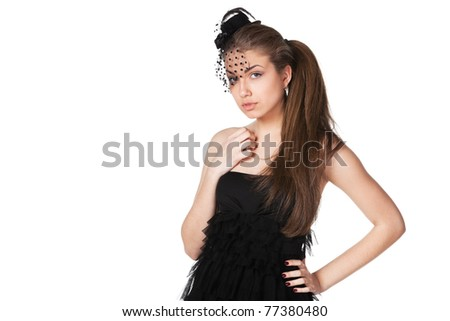 Portrait of young female in black cocktail dress and the hat with veil isolated on white background