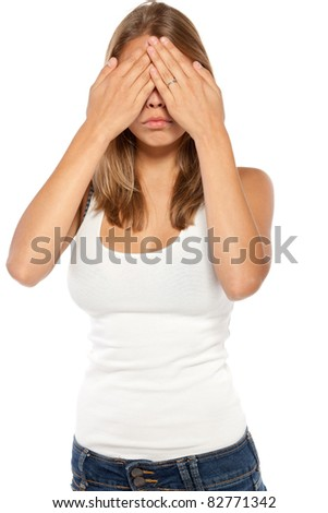 Portrait of young female in casual covering her eyes isolated on white background - stock photo