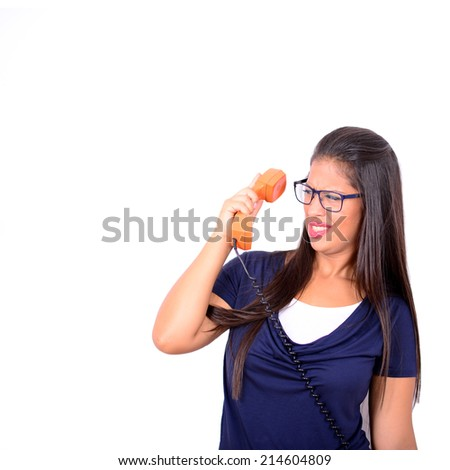 Portrait of young female in shock while talking on phone having unpleasant conversation against white background - stock photo