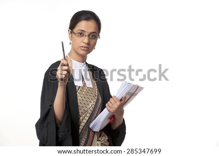 Portrait of young female lawyer holding pen and documents isolated over white background - stock photo
