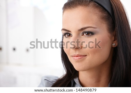 Portrait of young female, looking away. - stock photo