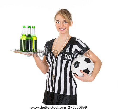 Portrait Of Young Female Referee Holding Drinks And Football - stock photo