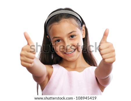 Portrait of young female showing a thumbs up - stock photo