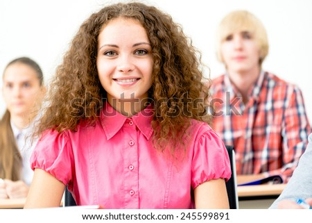 portrait of young female student in the classroom, teaching at the University of - stock photo